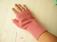 Fingerless gloves from old sweaters. BRILLIANT! I am so doing this. Much easier than the knit ones I have made.