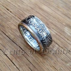 This Double-Sided Coin Ring is made from an 80% silver, 1958 Canadian 50 Cent piece. It has been meticulously Hand-Crafted in true Artisan Style.