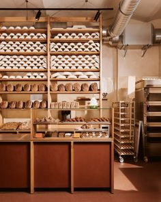 The layout of this craft bakery in Berlin revolves around an open kitchen that showcases the beauty of the bread-making process. Tulum, Display Shelves, Shelving, Ibiza, Restaurants, Supermarket Shelves, Communal Table, Vintage Cutlery, Lokal