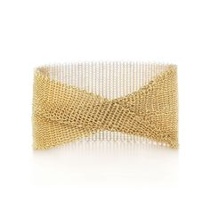 """The form is malleable and ergonomic in the way it drapes over the body's contours. Wide bracelet in 18k gold. Medium, fits wrists up to 6.25"""" in circumference. Original designs copyrighted by Elsa Peretti 