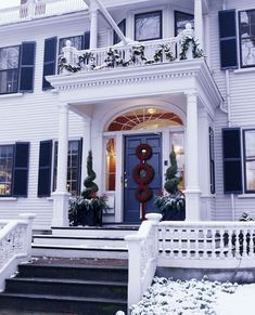 LOVE LOVE LOVE this...white house with black shutters!  Gorgeous Christmas greenery too!