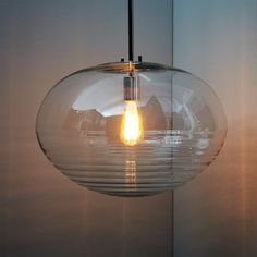 This would be pretty in the kitchen (and work well with the wine bottles in DR) Ripple Glass Pendant - Oval | west elm