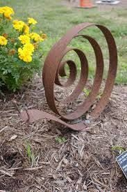 Image result for scrap steel garden art