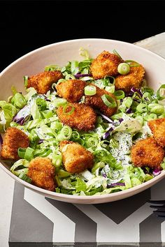 This quick and easy 35-minute popcorn chicken salad recipe incorporates chicken tenders, Greek yogurt, parsley, chives, dill, romaine lettuce, coleslaw mix and scallions to create the ultimate chicken salad recipe. Whether you're looking to eat this salad for an appetizer, light lunch or side dish, it's a great choice for a healthy recipe. #saladrecipes #healthysalads #chickenrecipes #popcornchicken #chickensalad #chickensaladrecipes