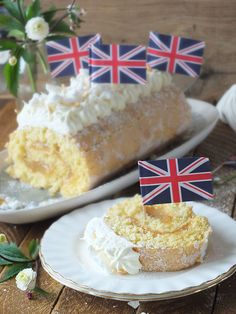 A celebration cake made in honour of Henry and Meghan's Royal Wedding. A swiss roll sponge is filled with sharp lemon curd and decorated with an elderflower scented whipped cream frosting and crumbled meringue pieces.