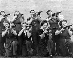 UK: The women who make Sten guns show off their handiwork. Via the Imperial War Museum.
