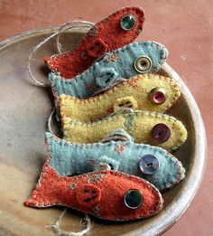 felted fish- I wonder if you put a magnet inside the face if you could use a dowling rod  and go fishing?