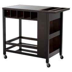 Bar Cart from Target.  Mirrored bottom shelf with cubbies for wine and shelves for glasses. Looks a little big but will keep it in mind.  15% off + free shipping on target.com.