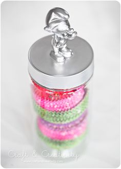 Glue figure to lid and spray paint one color!  Great idea for a jazzy jar!