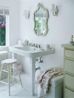 Cozy Bath              An antique mirror and curvy sconces bring a vintage feel this bathroom, where the homeowner installed hexagon-tile flooring and a pedestal sink to evoke another era