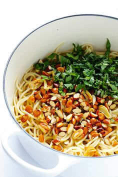 Lemon Basil Spaghetti with Almonds -- quick and easy to make, full of zesty garlic lemon flavor, and topped with a sprinkle of Parmesan. So delicious! | gimmesomeoven.com