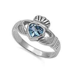 Silver Irish Claddagh Ring with aquamarine heart.  Claddagh rings have three distinctive symbols - hands to signify friendship, a heart to symbolize love, and a crown which represents loyalty.  Pretty cool!!