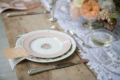 rustic vintage country wedding table setting with silverware and crockery