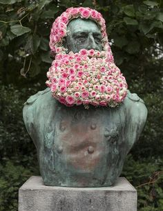 artist geoffroy mottart reinvigorates the often overlooked, historic busts found in parks and public spaces across belgium with a floral touch. bronze and stone statues depicting the likes of leopold II, hermes and the goddess of bocq are adorned with quirky botanical beards and blossoming hairstyles. 'this idea came to me because I realized that most people pass by these statues without paying attention to them,' the artist says.
