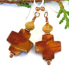 Evoking the soul satisfying, earthy colors of the Desert Southwest, the LAS CRUCES handmade gemstone earrings will be a stunning addition to the collection of a woman who loves Christian cross jewelry. Created with red creek jasper crosses, American picture jasper lantern beads, copper and sterling silver, each cross is lovely no matter which side is hanging in front.