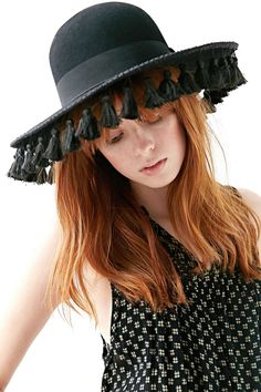 shy attic beauty in inelegantly trimmed hat