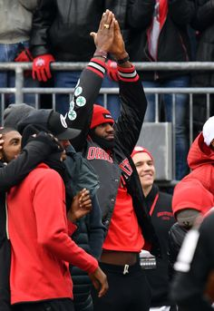 LeBron James Photos Photos - Lebron James of the Cleveland Cavaliers reacts on the sidelines after a big play by the Ohio State Buckeyes against the Michigan Wolverines at Ohio Stadium on November 26, 2016 in Columbus, Ohio. - Michigan v Ohio State