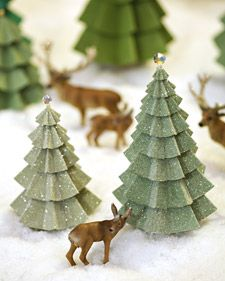 Martha Stewart's Tutorial for paper Evergreen ornaments.  Use book pages for a pretty tree.