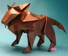 Learn to make an origami lion by T Gotani. This is a hard model so be prepared. Free origami instructions for lots of models Origami Lion, Origami Horse, Origami Star Box, Origami Dragon, Origami Animals, Origami Stars, Useful Origami, Origami Easy, Dollar Origami