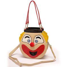 HANDBAG - approx $60.   Smiley bags double faced clown hand bag.