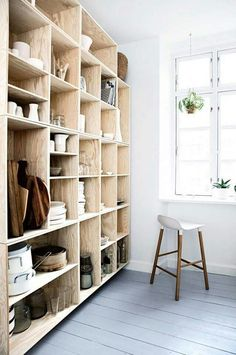 Open shelving in this small kitchen keeps everything neat, yet easy to find. The shelves are light in color, so they don't make the room fell cramped. Plywood Shelves, Decor, House Interior, Open Shelving, Home, Interior, Black Walls Kitchen, Shelving, Home Decor