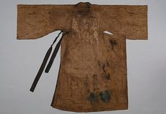 """Danryeong (Official Robe with Round Neck) """"Excavated from a tomb of the Jeonju Choi clan, dating to the 17th century. 141 cm long, and 54 cm wide.  """"The unlined danryeong is made of fine tabby silk with small floral pattern. The expanded side panel, mu, in the front is folded and fixed inside. The hem line without expanded side panel (mu) is similar to the wonsam. A small gusset is attached under the armpit of the robe."""" Dankook University Seok Juseon Memorial Museum."""