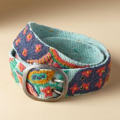 "WATER LILY BELT -- Our vibrant wool belt brightens any wardrobe. Wool. Imported. Exclusive. Sizes S (0 to 4), M (4 to 8), L (8 to 12). 2""W."