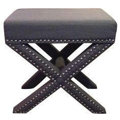 Grey Nailhead Trim X-Bench. The brass nail detailing makes this bench unique and stylish.