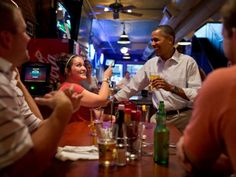 Obama jokes with the bartender at the Pump Haus Pub and Grill in Waterloo, Iowa. The President revealed his love of beer during the 2012 race, and even brought bottles of the White House brew along with him on campaign swings.