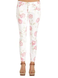 Just USA Women's Flower Print Skinny in White Who says that jeans only need to be blue? Pick up a pair of these white skinny jeans with a fun and flirty pink floral pattern! Floral patterns have never looked this good or this curvy. Make them pop with some saucy black heels or play up the pastels with your favorite spring and summer colors!