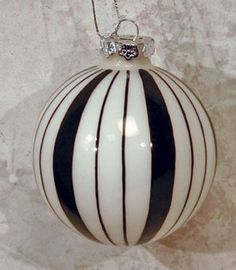 DIY - Fill inside of glass ornament with white paint then on outside, draw pattern with black Sharpie or paint on pattern