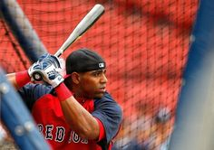BOSTON, MA - AUGUST 3: Yoenis Cespedes #52 of the Boston Red Sox takes batting practice before a game with the New York Yankees at Fenway Park on August 3, 2014 in Boston, Massachusetts. (Photo by Jim Rogash/Getty Images)