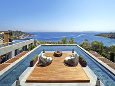 This rooftop sun-deck and pool designed by Scape Design Associates, can be found at the Mandarin Oriental Hotel in Bodrum, Turkey. Mandarin Oriental, Beach Hotels, Hotels And Resorts, Beach Resorts, Swimming Pool Designs, Swimming Pools, Piscina Do Hotel, Paradise Bay, Rooftop Pool