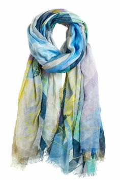 This lightweight cotton-cashmere blend scarf is graced with oceanic shades of blue and green set in a geometric-kaleidoscope print.