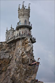 Cliff diving competition from Swallow's Nest Castle, Crimean Peninsula, Ukraine.