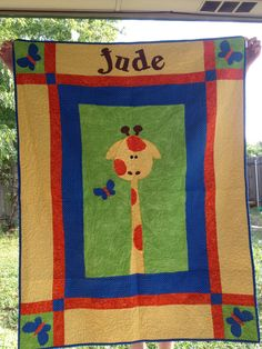 Giraffe quilt for my nephew. My first quilt made completely on my home machine.
