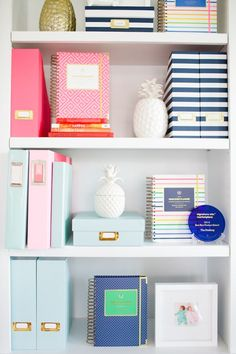 Close up of Emily's styled shelves. Office shelving: http://www.stylemepretty.com/living/2015/09/09/behind-the-scenes-emily-ley/ | Photography: CIHI Photo - http://www.cihiphoto.com/