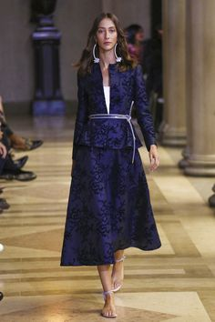 This season designer Carolina Herrera moved her fashion show to the rarefied air of The Frick museum on the Upper East Side of New York. The more intimate setting made for a perfect backdrop to a c...