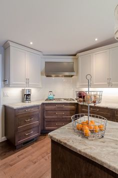 Shaker Kitchen - shaker style cabinets, two toned cabinets, granite countertops, island seating, corner cooktop