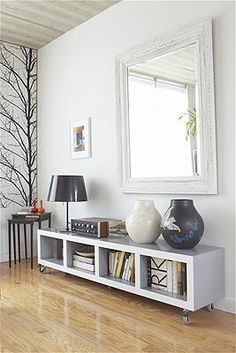 Anastassios Mentis/Getty Images  could use Ikea bookcase turned on side, add leg or not...etc.  add mirror over top