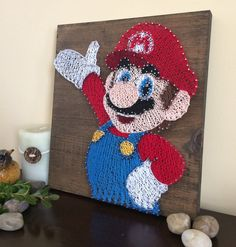 It's me! Mario! I don't want to mention how long this took to make, but I enjoyed creating my fav character into String Art
