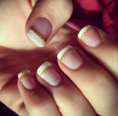 French white tips with gold glitter outline in shellac by Evie x