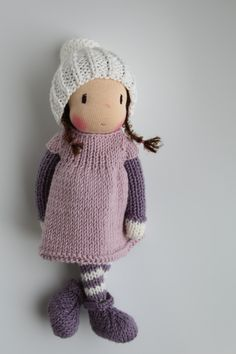 Sweet little Phoebe. Phoebe is a little knitted Waldorf inspired doll made in The Netherlands from all natural materials: Swiss cotton knit doll fabric, clean carded wool, eco and fairtrade hand dyed merino yarn and a crocheted curly mohair wig. Her face is hand embroidered and her cheeks are blushed with Stockmar beeswax crayon. She is about 7-8 inch (18-20 cm tall). This sweet little doll will become your very best friend. Phoebe is handknitted by me from luxuriously soft eco and…