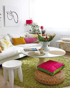 Like the idea of eclectic cushions / stools around coffee table to add seating