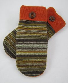 Multi colored stripes of oranges, limes, golds and browns with a wine and orange palm. Created from upcycled wool sweaters. The sweaters are
