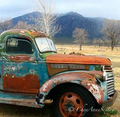 Chevy Old Brown Blue and Rust Pickup Winter by newmexicomtngirl