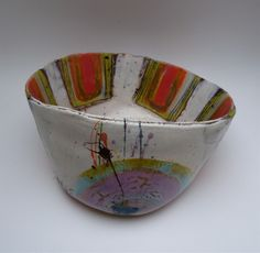 Medium bowl with purple lustre and gold detail to interior, orange on yellow stripes inlaid with deep blue, 18cmsH x  31cmsW Linda Styles