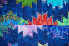 close up,  Delicious Mountains quilt by Rebecca L Salinger.  Embroidered blocks. Austin Area Quilt Guild 2014 show.