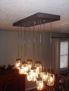 More great tips on how to create a mason jar chandelier - thinking of also wrapping a rectangle lamp shade around the whole thing...
