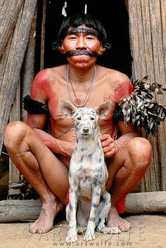 Yanomamo man and hunting dog, Parima-Tapirapeco National Park, Venezuela